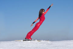 The woman on skis bent forward Royalty Free Stock Photography