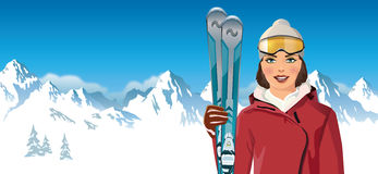 Woman with skis in the mountain Stock Photo