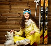 Woman with skis and ski boots Royalty Free Stock Images