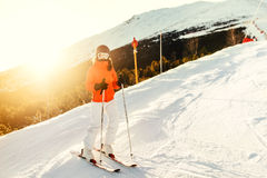 Woman on skis during winter. Girl skiing in a mountain resort on the slopes. Portrait of woman on skis during winter season. Girl skiing in a mountain resort on Stock Images