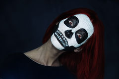 Woman with skull face art Stock Images