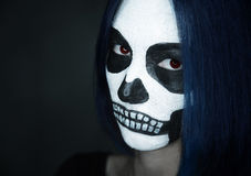 Woman with skull face art. Portrait of young woman with skull make-up. Halloween face art Stock Photo