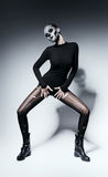 Woman with skull posing in black clothing. In studio Royalty Free Stock Images