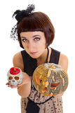 Woman with skull and a pumpkin Stock Photography