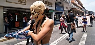 Woman Skull undresses in social protest stock images