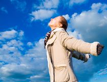 Woman and the sky Stock Photography