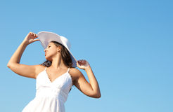 Woman in sky with hat Royalty Free Stock Photo