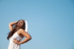 Woman in sky with hat Stock Photography