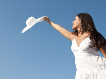 Woman in sky with hat Stock Image