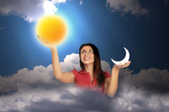 Woman in sky holds moon and sun, collage Royalty Free Stock Photos