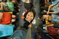 Woman in skytrain. Smiling little Asian woman in the Bangkok skytrain, view from above Stock Photography