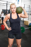 Woman with slam ball at fitness gym center Royalty Free Stock Photography