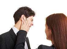 Woman slaping businessman. In the face after sexual harrasment Royalty Free Stock Photo