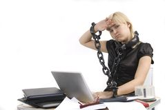 Woman slave of her work with portable pc Royalty Free Stock Photography