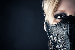 Woman slave in a mask with spikes. Portrait of a woman slave in a mask with spikes Stock Photo