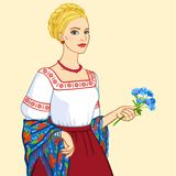 Woman of Slavic appearance in ancient clothes, a portrait isolated on a beige background. Vector illustration Woman of Slavic appearance in ancient clothes, a Stock Photo