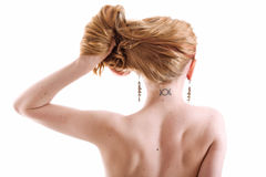 Woman with slavonic moon rune tattoo on neck. Young woman with slavonic moon rune tattoo on neck Royalty Free Stock Images