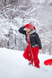 Woman with slay in winter. Young woman having fun in the snow, pulling a slay on the slope Stock Images