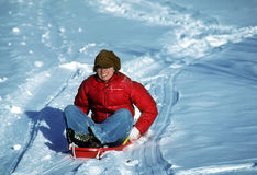 Woman on sled Stock Images