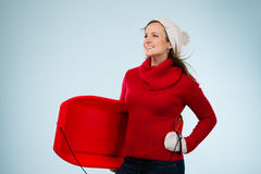 Woman and sled Stock Images