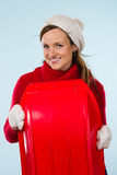 Woman and sled Royalty Free Stock Photography