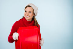 Woman and sled Royalty Free Stock Photos