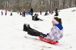 Woman sledding down snowy hill 3 Royalty Free Stock Photo
