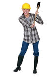 Woman with a sledgehammer Stock Photo