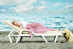 Woman sleep on beach Stock Image