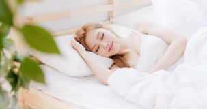 Woman sleep on the bed. At home in morning royalty free stock photo