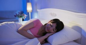 Woman sleep on bed. Woman sleep on the bed at night royalty free stock photos