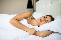 Woman sleep in bed. View from above Stock Photography