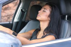 Woman sleep in car. Beautiful woman is sleeping in a car royalty free stock image
