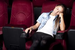 Woman sleep in the cinema Stock Photos