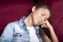 Woman sleep in the cinema Stock Photo