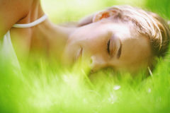 Woman sleep on grass. Woman sleep on green grass Stock Images