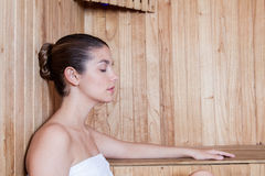 Woman sleep inside the sauna Royalty Free Stock Photography