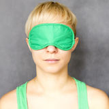 Woman in sleep mask. Portrait of young beautiful woman in sleep mask Stock Images