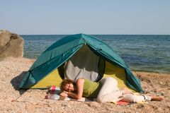 Woman sleep near of tent at seaside Stock Photography