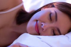 Woman sleep well on bed royalty free stock image