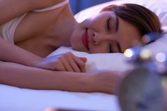 Woman sleep well on bed royalty free stock images
