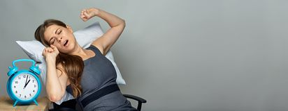 Woman sleep at working place with alarm Royalty Free Stock Images