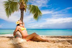 Woman sleeping. Woman relaxing on beach with turquoise waters Stock Image