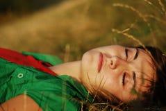 Woman sleeping. Pretty young woman sleeping outdoors Stock Photography