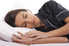 Woman sleeping Stock Images