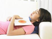 Woman sleeping Stock Images
