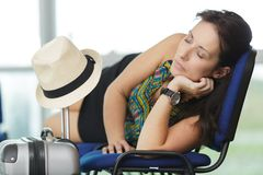 Woman sleeping in airport terminal stock photo