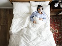 Woman sleeping with an anti-snoring mask Stock Photography