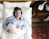 Woman sleeping with an anti-snoring mask Royalty Free Stock Photography