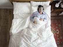 Woman sleeping with an anti-snoring mask Royalty Free Stock Photos